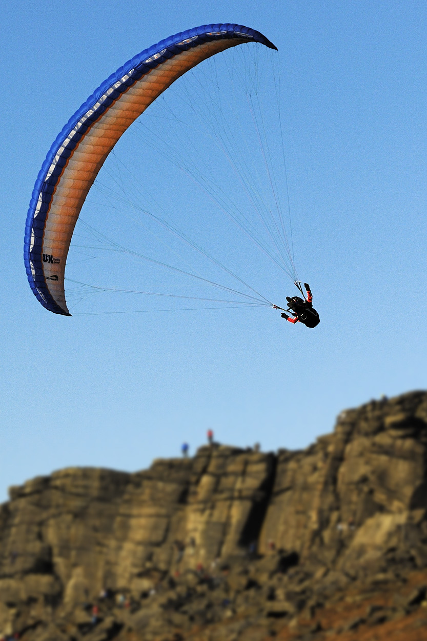 Paraglider above Stanage