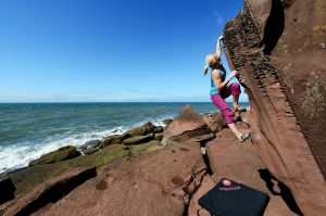 Leah Crane on the uber classic Apiary Arete (Font  5), St Bees, Cumbria