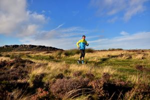 Steve Franklin running off Stanage, Dark Peak
