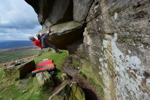 It's tough, but someone has to test rock shoes! The new Pinks from 5.10 hanging out off Hampers Hang, Stanage