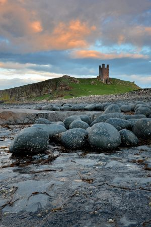 Dusk falls over Dunstanburgh Castle