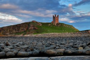 Dunstanburgh boulders await the incoming tide