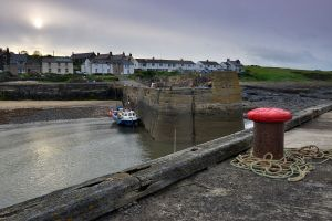 Night falls over Craster harbour as late-evening 'crabber' hang in