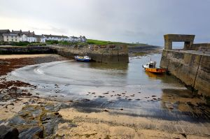 Low tide renders Craster harbour silent