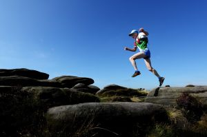 Tony Whithouse running above Stanage - Peak District