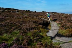 Tony Whithouse running off Stanage - Peak District
