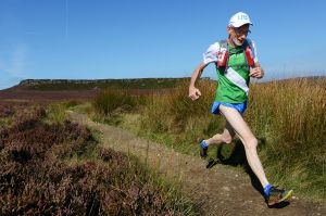 Tony Whithouse running away from Stanage - Peak District