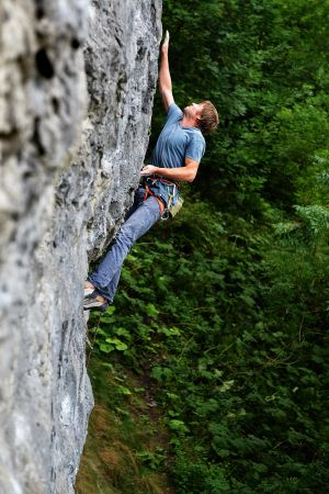 Kris Clemmow stretching out on Mystical Attainment (F7c), Long Wall, Chee Dale