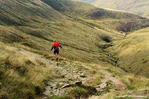 Ian Winterburn running down Doctor's Gate, Peak District