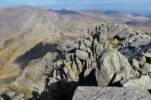 Tryfan and Bristly Ridge with walkers beginning the scramble up the ridge in the botton left
