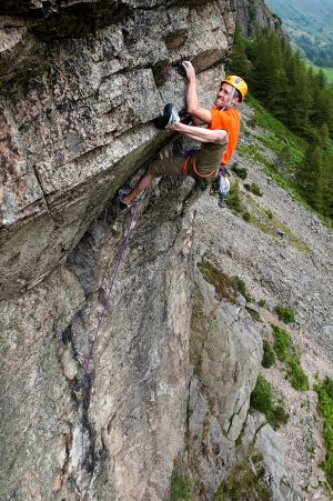 Climbing 2012:Poster - Steve McClure crushing Dawes Rides a Shovel Head E7/8 6c on Raven Crag