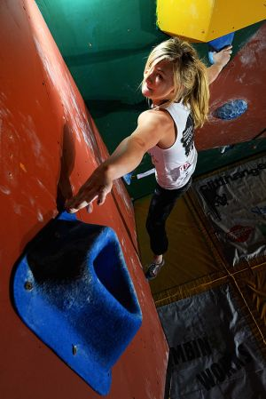 Cliffhanger 2012 - Shauna Coxsey stretching for the title as well as the finishing hold on problem #3