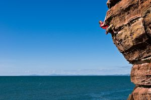 2011 Calendar Comp winner Liam Lonsdale climbing Dreaming of Red Rocks at St Bees