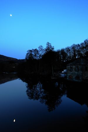 Curbar Gap and full moon from Calver Bridge